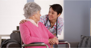 nurse and elderly woman talking